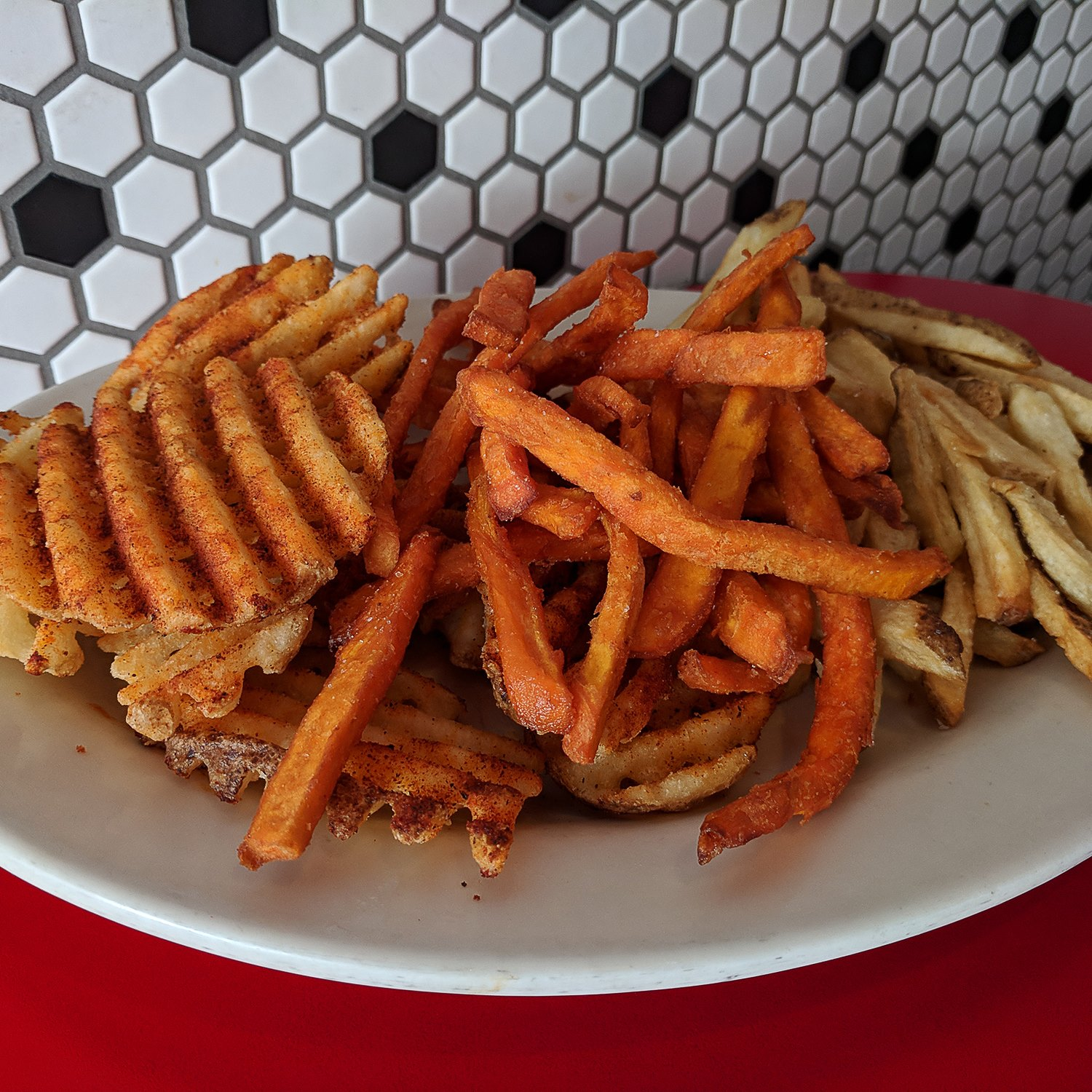 image of seasoned waffle, sweet potato, and normal fries from the chicago diner