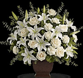 arrangement of white lilies with white roses