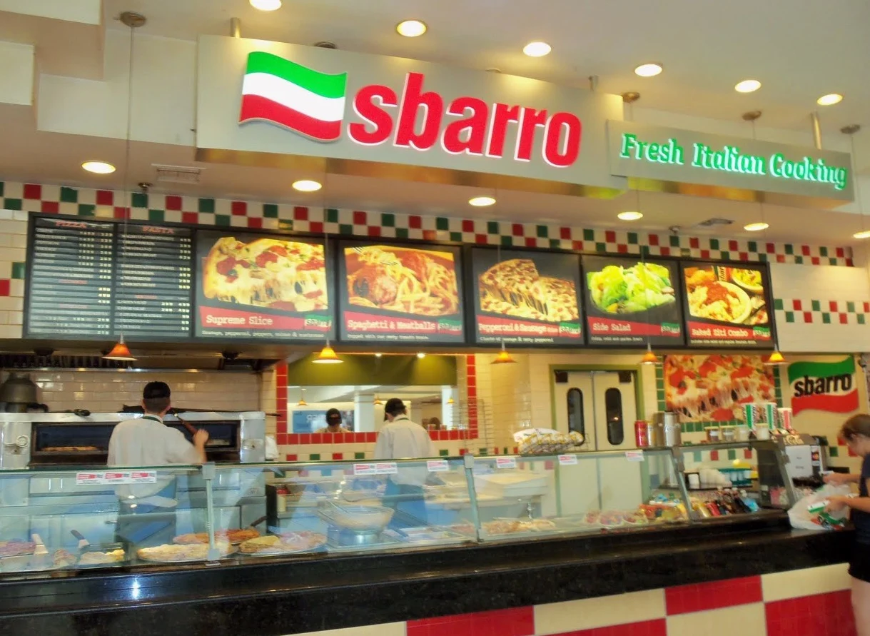 image of the counter and menu board of a sbarro pizza